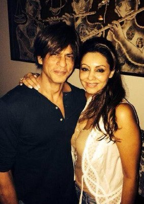 Gauri Khan and Shah Rukh Khan pose for the camera at the birthday bash