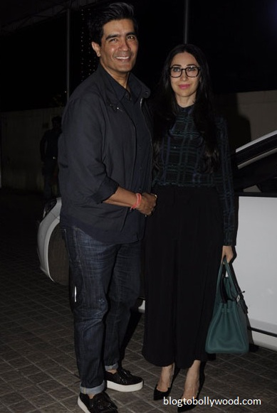 Costume designer of 'ADHM' Manish Malhotra poses with Karisma Kapoor