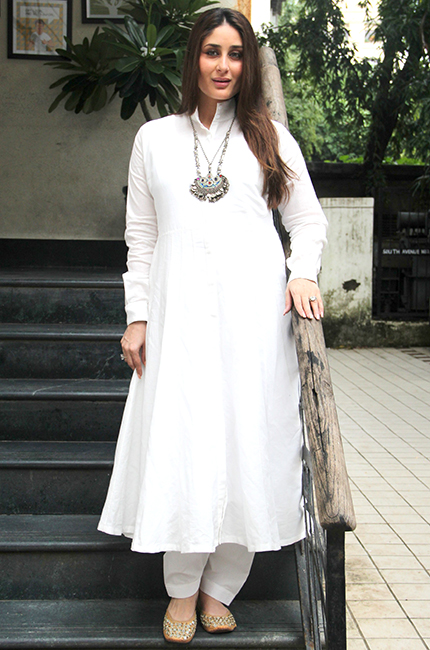 Kareena styles a simple White churidhar with metallic neck piece