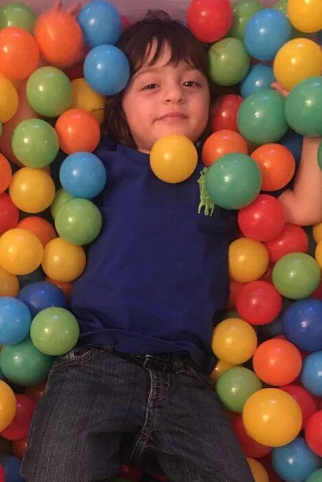 Abram surrounded by balloons