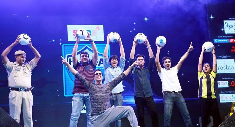 Akki poses with the young football fans
