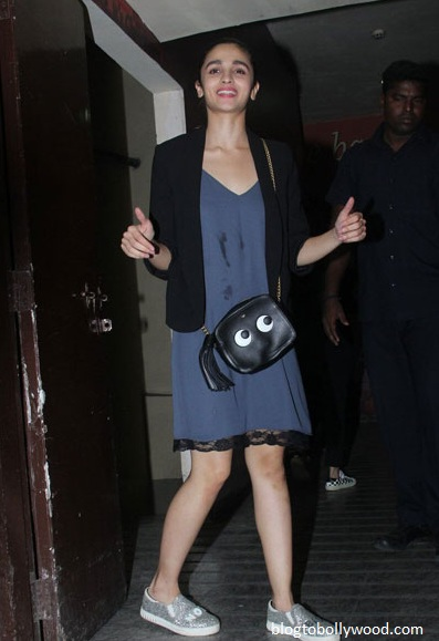 Alia Bhatt looks cute in a little dress paired with a black shrug and vans shoes