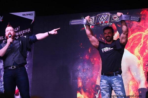 John Abraham holds the WWE champion belt