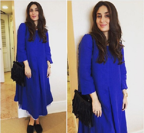 A royal blue dress with black accessories looks gorgeous on Bebo