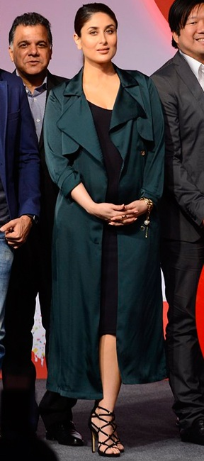 Bebo stuns us in a black dress with olive-green coat
