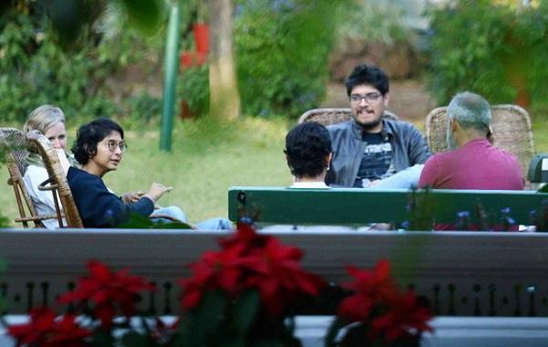Junaid Khan, Aamir Khan and Kiran Rao seen chatting with their friends in the garden