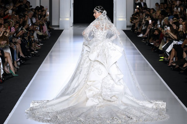 Sonam flaunts the long embellished train of her Ralph & Russo bridal gown